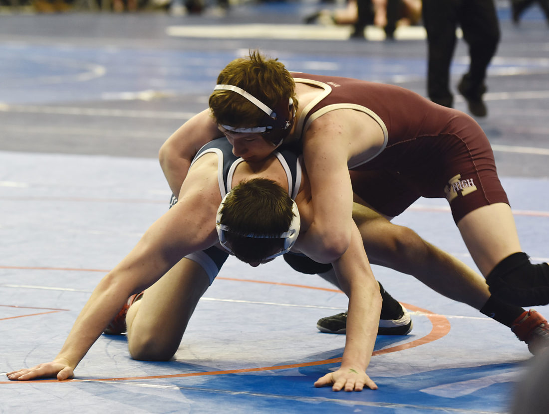 Garrick Hodge/MDN Minot High's Triston Walsh, top, tries to take control of Valley City's Jonathon Langer, bottom, during Minot's opening dual at the state wrestling tournament Thursday in Fargo.