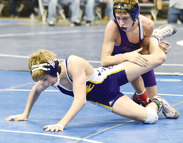 Garrick Hodge/MDN Bishop Ryan's Kersey Harris, bottom, tries to escape from Harvey-Wells County's Isaac Felchle, top, during the 106-pound quarterfinals at the state wrestling tournament Thursday in Fargo.