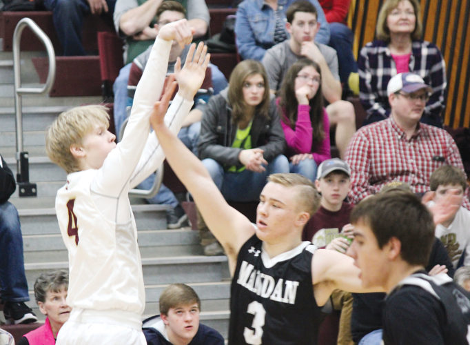 Alex Eisen/MDN Minot High junior Chandler Albertson (4) buries a 3-pointer in the first half Friday evening in a conference game against Mandan at Minot High School.