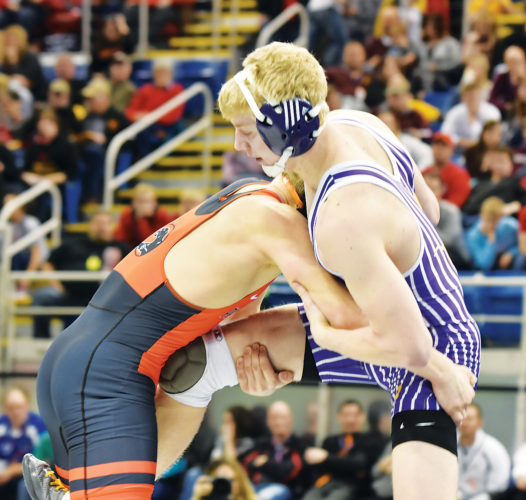 Garrick Hodge/MDN Bishop Ryan's Konner Beeter, right, wrestles Rugby's Kaden Jaeger, left, during the Class B 152-pound match Saturday at the Fargodome. Beeter won the title by pinning Jaeger.