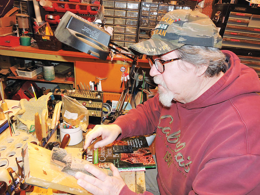 "Kim Fundingsland/MDN Paul Simonson carves a ""Wood Spirit"" from cottonwood bark. The Minot man says no two Wood Spirits are the same."