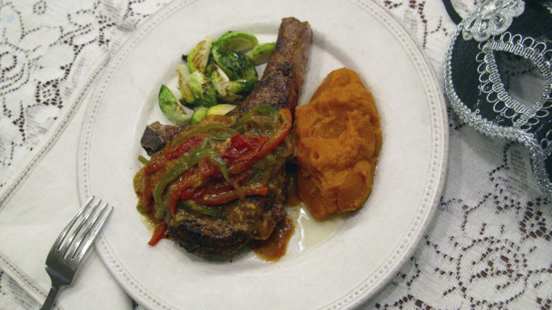 This Jan. 23, 2017 photo shows a spicy pork chop with Creole mustard sauce. This dish is from a recipe by Sara Moulton. (Sara Moulton via AP)