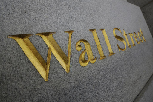 In this Oct. 2, 2014, file photo, Wall Street is etched in the facade of a building in New York's Financial District.  Stocks are opening higher on Wall Street, Tuesday, Feb. 21, 2017,  as investors return from the holiday weekend in a buying mood. (AP Photo/Richard Drew, File)