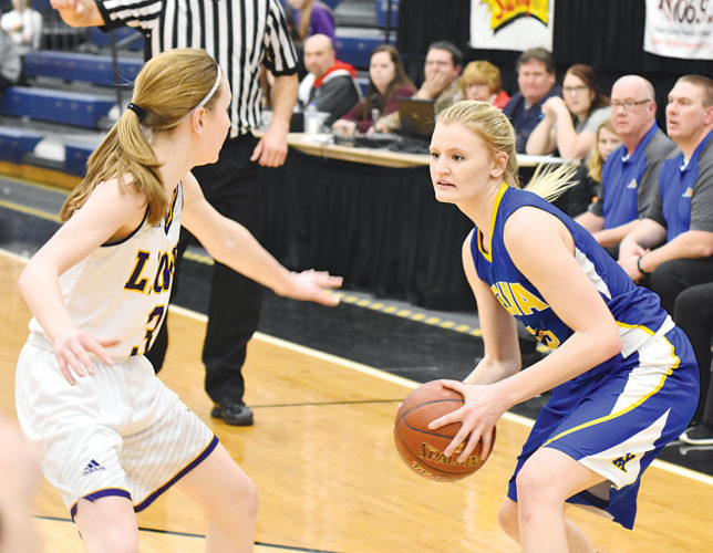Garrick Hodge/MDN Velva-Sawyer's Jonnah Lee (5) drives to the lane while being guarded by Bishop Ryan's Shayla Elm (3) during the Region 6 semifinals Tuesday night at the Minot Municipal Auditorium.