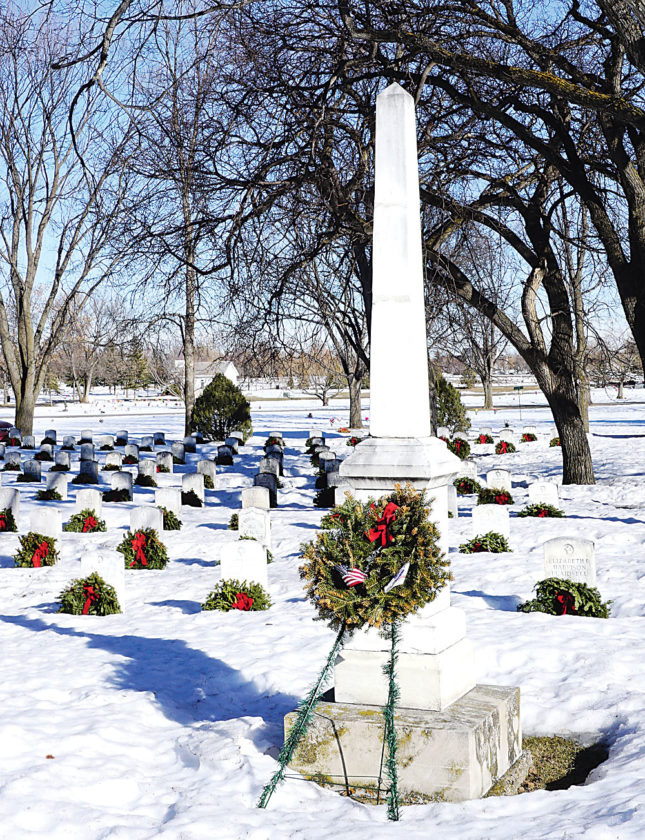Jill Schramm/MDN A monument erected by the Minot Girls Military Squad for fallen World War I soldiers stands in the veterans section of Rosehill Memorial Park Feb. 20.