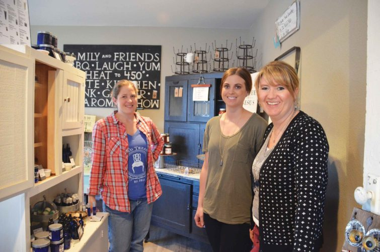 Eloise Ogden/MDN   From the left, Rachael Walz, Kelsey Beechie and Sara Seykora, operating partners, are shown in the Market on 4th along Minot's Fourth Avenue Northwest. They said repurposing gives an old piece of furniture or other item new life.
