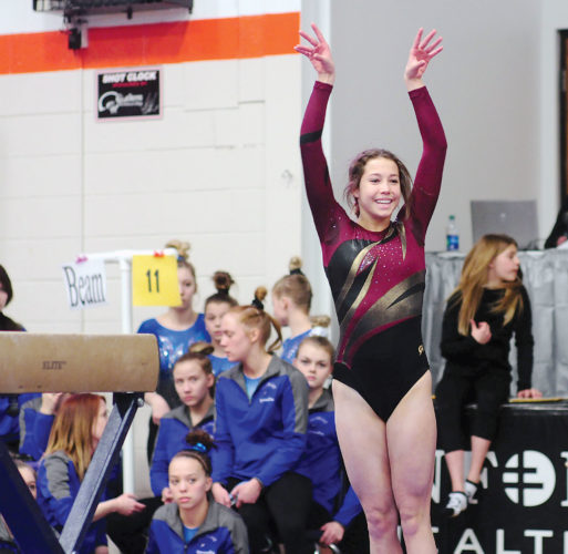 Photo courtesy of Parker Cotton/The Dickinson Press Adisynn Widdel of Minot smiles after performing her balance beam routine on Friday at Dickinson High School.