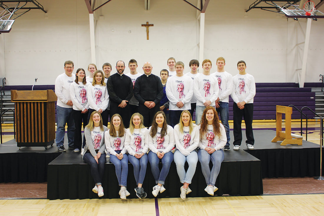 Submitted Photo Many seniors at Bishop Ryan Catholic School are assistant chaplains who assist school chaplain the Rev. Douglas Krebs at Mass and with setting up events.