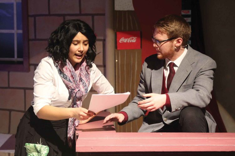 """SubmittedPhoto  From left to right, Emma, played by Alayzia McLeod, tries to reason with her classmate turned teacher Mr. Jeff Knightly, played by Micah Carter, during """"Emma!,"""" opening tonight and running through Saturday at Minot High School-Central Campus."""