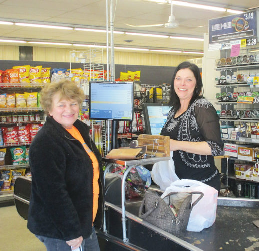 Allan Blanks/MDN Karma customer Debbie Dunn has a light hearted conversation with Shannon Michels, the manager of Karma Convenience Store located at 600 3rd St. NE, Minot.