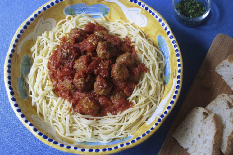 This Feb. 3, 2017 photo shows meatballs with spaghetti in New York. This dish is from a recipe by Sara Moulton. (Sara Moulton via AP)