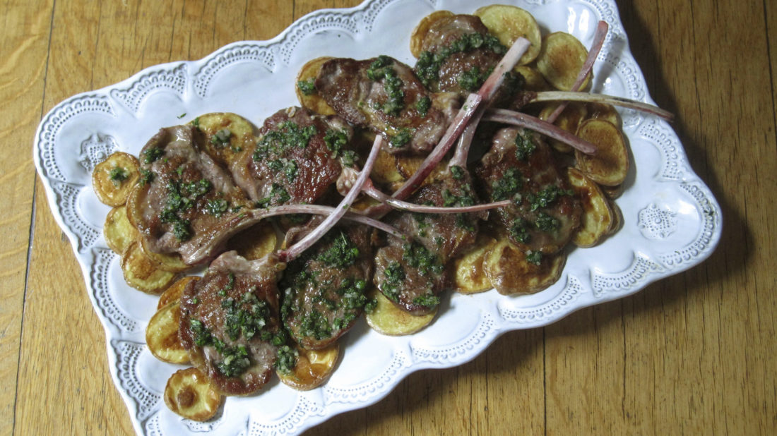 This Feb. 8, 2017 photo shows seared lamb chops with mint herb sauce in New York. This dish is from a recipe by Sara Moulton. (Sara Moulton via AP)