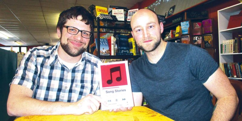"Allan Blanks/MDN   Fargo native and ""Song Stories"" author Kyle Bylin, left, sits beside Minot native and contributor Derek  Pinnick."