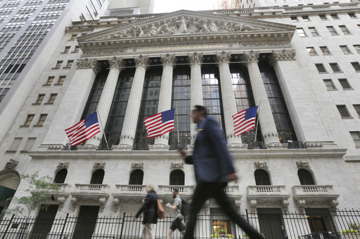 FILE - In this Friday, June 24, 2016, file photo, people walk by the New York Stock Exchange. Stocks were mixed in early trading on Wall Street, Friday, March 17, 2017, with only health care and financial stocks posting losses. (AP Photo/Richard Drew, File)