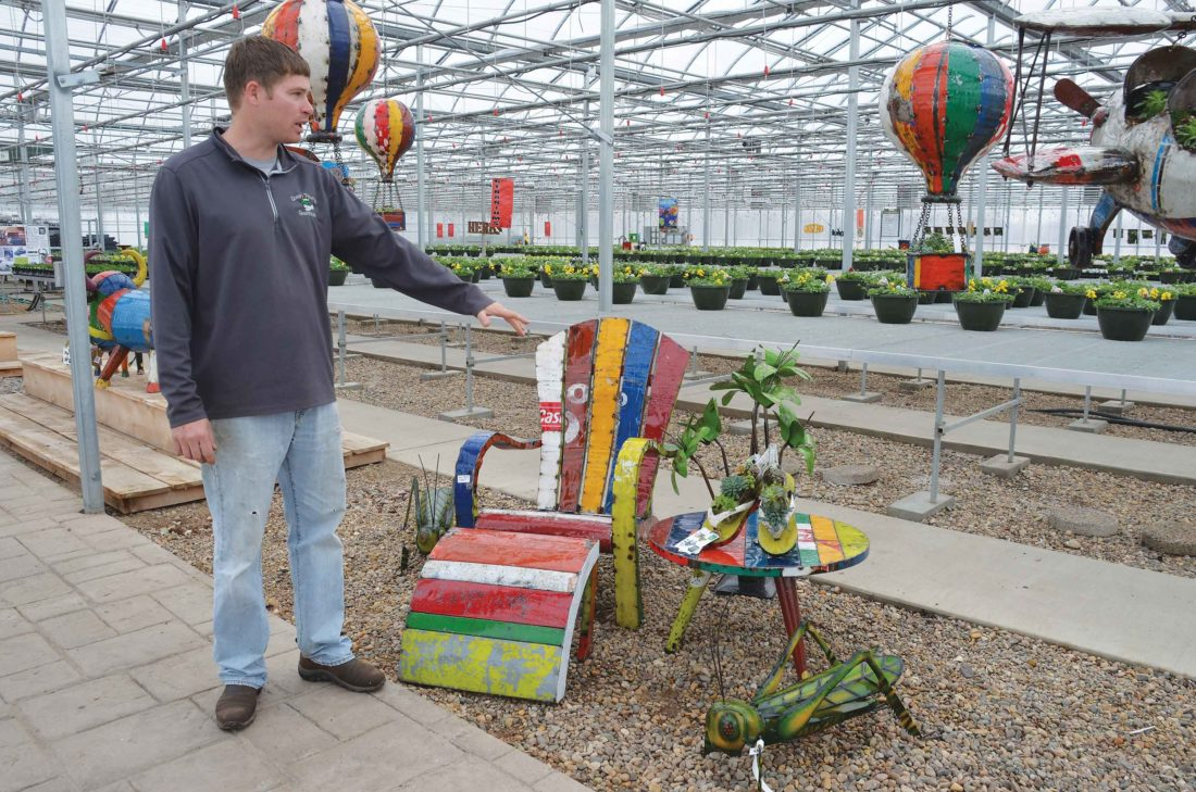 Eloise Ogden/MDN  Calvin Berry, co-owner of Green Thumb Greenhouse, west of Minot, said container gardening is a popular way to grow flowers and vegetables.