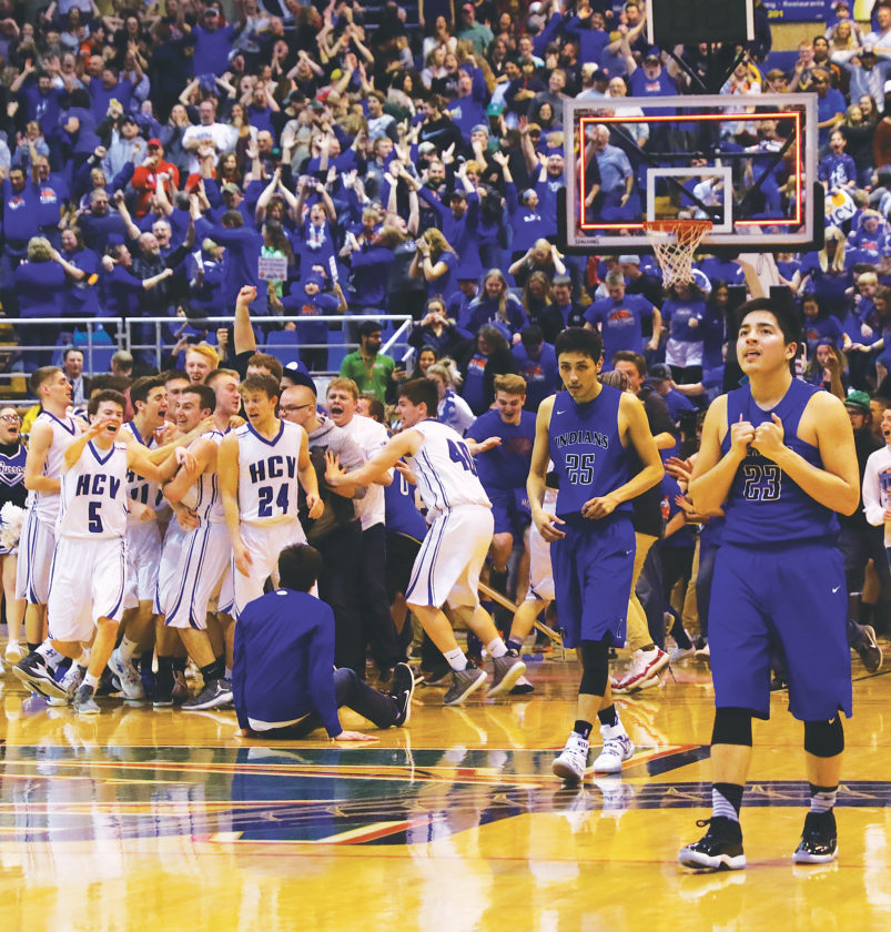 Garrick Hodge/MDN  Hillsboro/Central Valley players celebrate winning the North Dakota Class B boys basketball state championship, while Four Winds/Minnewaukan's Tronis McKay (25) and Jacob Yankton (23) walk back to their bench after Kyle Henningsgard game-winning 3-pointer.