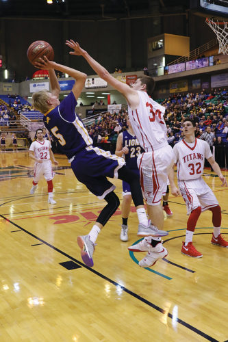Al Christianson/Special to the Minot Daily News Bishop Ryan's Mason Hedberg (5) shoots a fadeaway shot during the North Dakota Class B boys basketball state tournament fifth-place game Saturday at the MSU Dome in Minot.