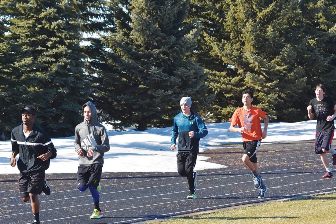 on your marks news sports jobs minot daily news garrick hodge mdn several minot high boys track and field athletes jog around duane carlson