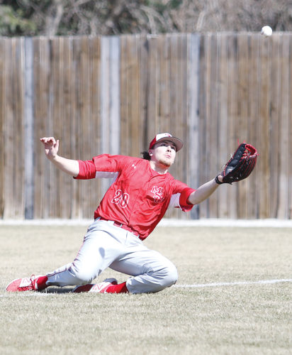 Photo courtesy of Sean Arbaut/Minot State athletics  Minot State utility man Michael Borst (20) makes a sliding catch during a game earlier this season.