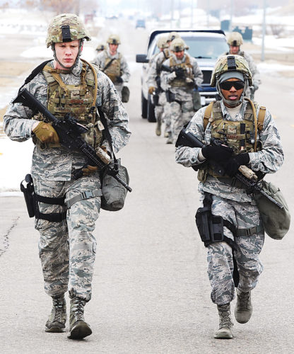 Submitted Photo Members of the 5th Security Forces Squadron run during a buddy run at Minot Air Force Base, March 16, shown in this photo by Senior Airman Kristoffer Kaubisch. The buddy run was part of tryouts for the 2017 Global Strike Challenge. The challenge is a bomber, intercontinental ballistic missile, helicopter operations and security forces competition with units from Air Force Global Strike Command, Air Combat Command, Air Force Reserve Command and the Air National Guard.