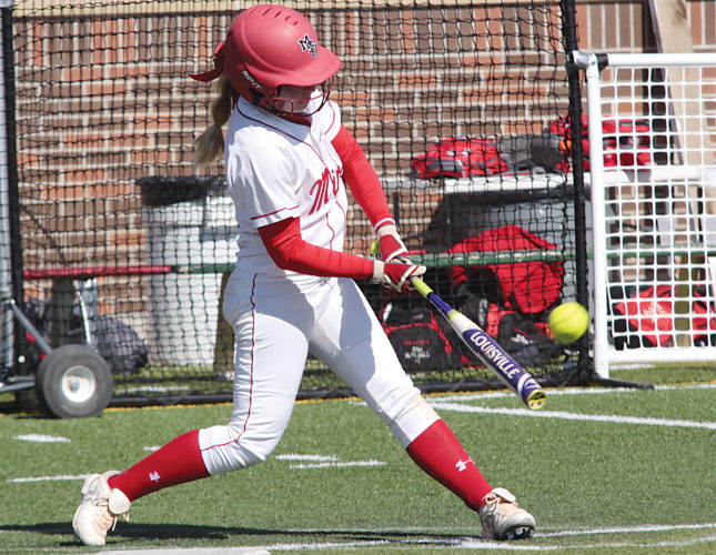 Submitted by Minot State Athletics Minot State utility player Rachel Burdette takes a swing at a pitch in a game played last season at Herb Parker Stadium.
