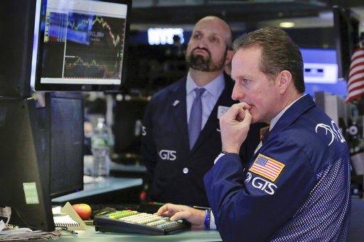 Specialists Glenn Carell, right, and James Denaro work on the floor of the New York Stock Exchange, Monday, March 27, 2017. Banks and industrial companies are leading stocks lower on Wall Street in early trading. (AP Photo/Richard Drew)