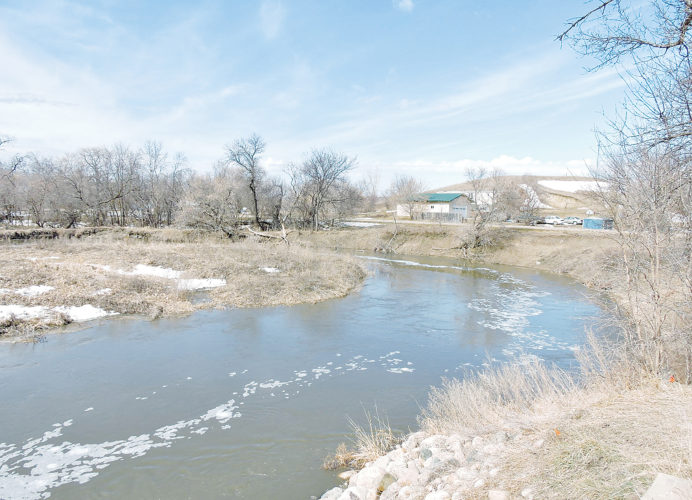 Kim Fundingsland/MDN The Des Lacs River was flowing well below bank level Monday afternoon and is expected to remain well within its banks throughout the runoff period.
