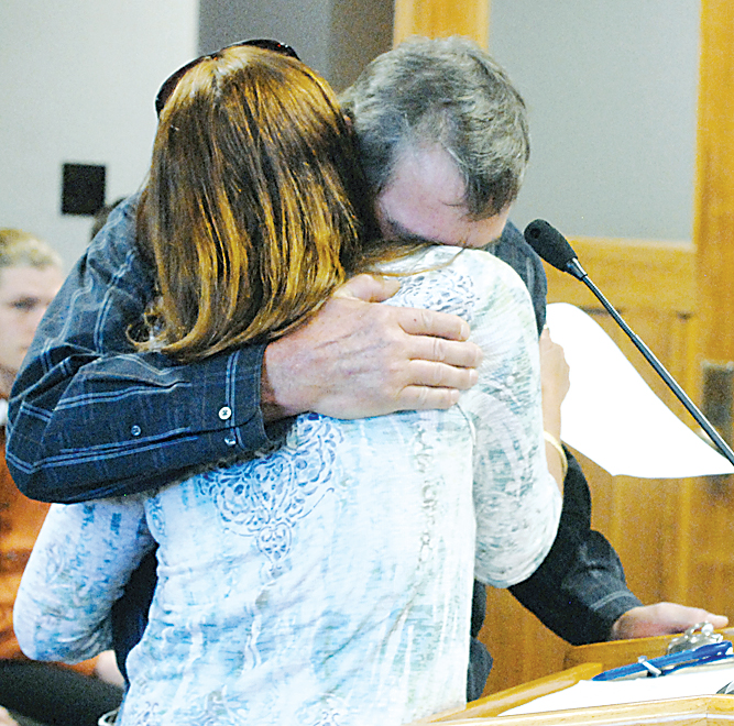 Bismarck Tribune Photo by Mike McCleary Tammy and John Sadek comfort each other after giving testimony before the Senate Judiciary Committee in support of a bill to reform confidential informant law. Their son, Andrew, died while working as a confidential informant in 2014.