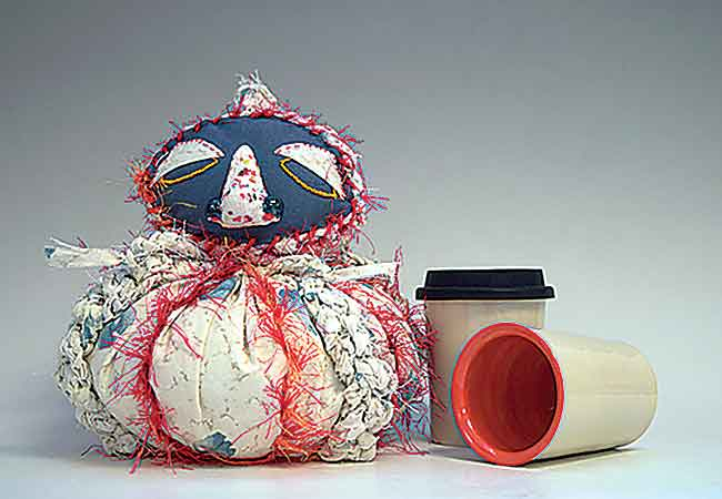 SubmittedPhoto  Fabric and ceramic monster by Rachel Alfaro; mugs by Kalyn Dewitt.