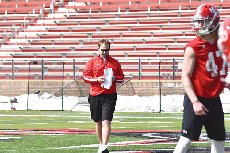 Garrick Hodge/MDN Minot State football coach Mike Aldrich calls a play during the first spring football practice of the year Wednesday at Herb Parker Stadium in Minot.
