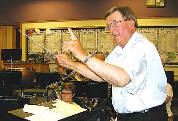 "Submitted Photo  Gordon Troxel, the conductor of the Brass Band of Minot, prepares his core of brass players and percussionists for their upcoming concert titled ""An Easter Celebration,"" Sunday in Ann Nicole Nelson Hall at Minot State University."