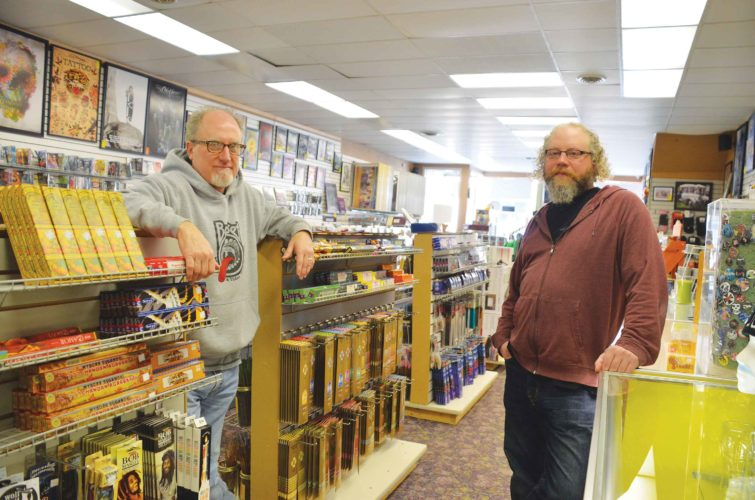 Eloise Ogden/MDN Jon Bauer, left, and Dylan Lee, managers of Budget Music & Video in downtown Minot, said the interest in vinyl has been building steadily and people of all ages are buying vinyl records.