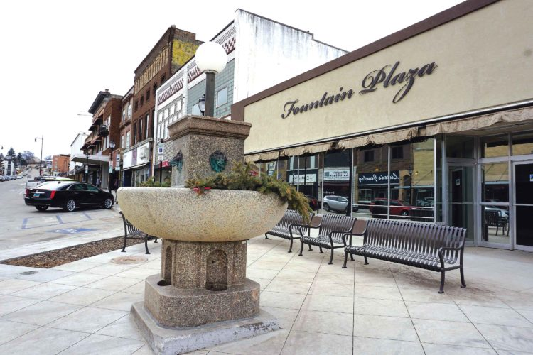 Jill Schramm/MDN  A historic fountain stands near an intersection in downtown Minot. Re-installed after the Main Street reconstruction in 2016, the fountain is plumbed for water in the summer.