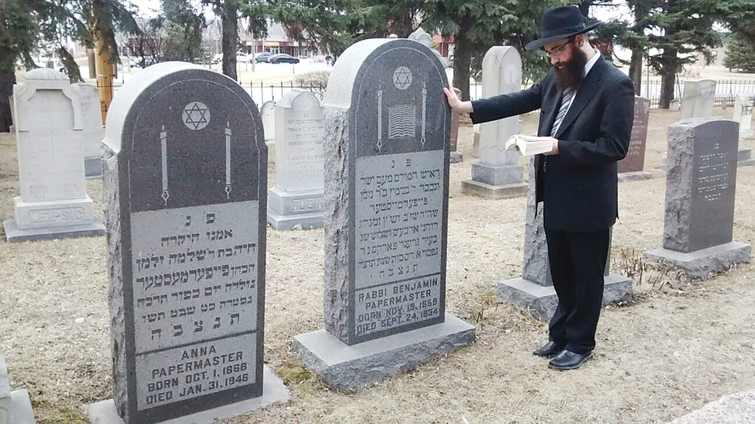 Submitted Photo Rabbi Shalom Ber Orenstein, of Brooklyn, N.Y., recites psalms at the resting site of his great-great grandfather, Rabbi Benjamin Papermaster.