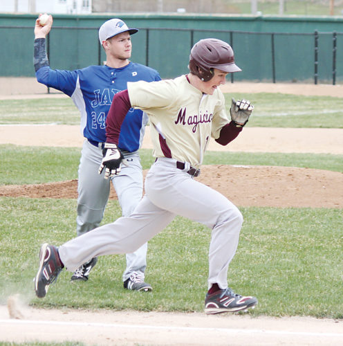 Alex Eisen/MDN Minot High junior Zachary Pedersen attempts to beat out the throw from Jamestown's Andrew Nohrenberg in the first game of a doubleheader played Tuesday at Corbett Field.