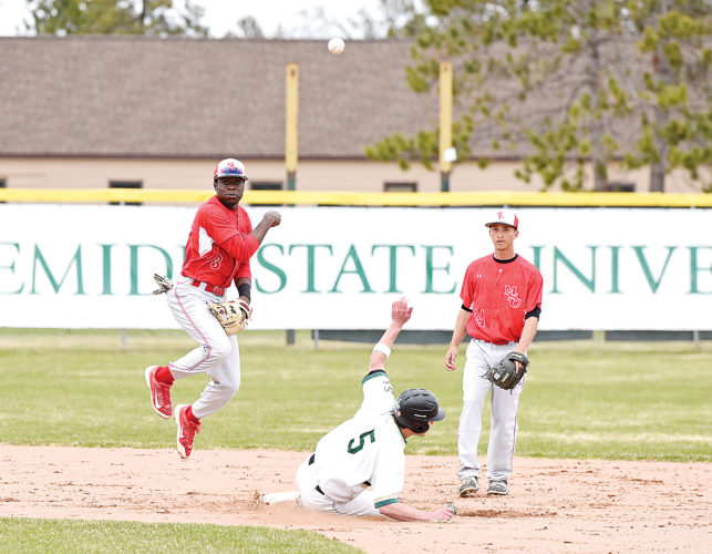 Jillian Gandsey/Bemidji Pioneer Minot State's Trevaun Smith (3) makes the double play as Bemidji State University's Cole Easley (5) slides unsuccessfully into second base in the third inning of the first game of the doubleheader on Wednesday at Bemidji State University.