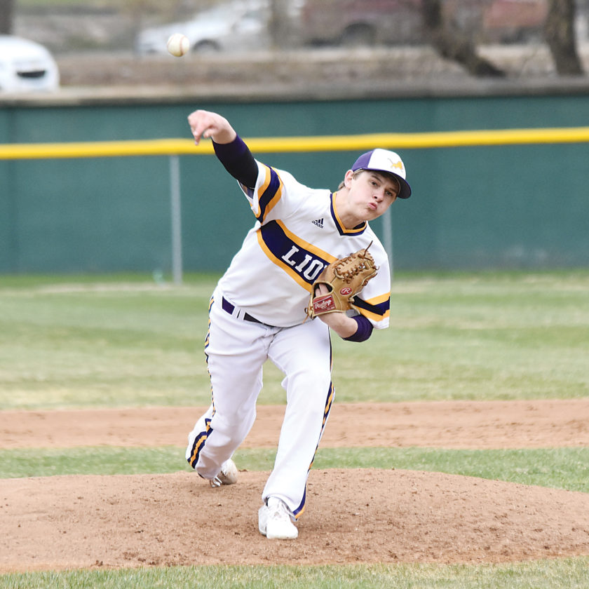Garrick Hodge/MDN  Bishop Ryan pitcher Alex Burckhard delivers a pitch to home plate during Ryan's doubleheader with Surrey Thursday at Corbett Field in Minot.
