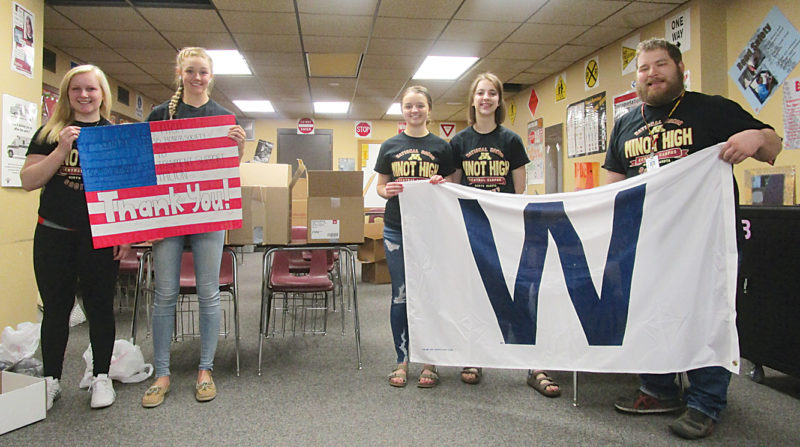 Allan Blanks/MDN From left to right, National Honor Society members Parker Larson, Raquel Egge, Abby Folk and Areana Altschuler hold banners with their adviser Nicholas Cavallo at Minot High School Central Campus.