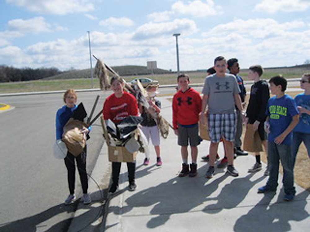 Submitted Photo Students at Erik Ramstad Middle School cleaned up the school grounds on Friday in honor of Earth Day.