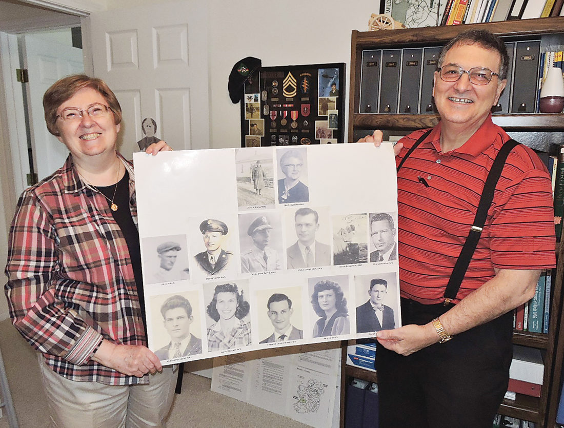 Kim Fundingsland/MDN Diane and Mike Kelly, Minot, hold a compilation of photographs of members of Mike Kelly's side of the family. The Kellys have conducted extensive research into their family history and help others do so as well.