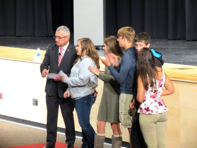 Morning Journal/Steve Rappach Jim Tressel tests students' knowledge on the steps and tips to success he shared during his speech. Students  received gift certificates for free pretzels from Auntie Anne's for the correct answers.
