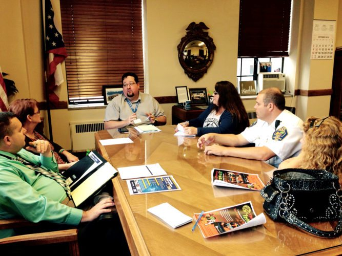 Morning Journal/Jo Ann Bobby-Gilbert Meeting to discuss a proposed DARE program and other drug-related issues in the city of East Liverpool are (clockwise, from left): Mayor Ryan Stovall; Cindy Anderson of Sean's Bridge to Hope; Service-Safety Director Brian Allen; East Liverpool's Got Talent President Pennie Zehnder; police Chief John Lane; and ELGT Director Amy Hissom-Daugherty.