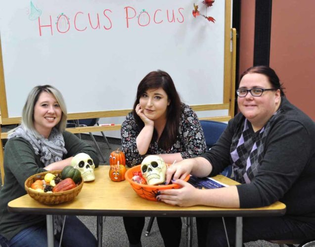 "Submitted photo  Kent State-Salem English Club members (from left) Hannah Satterfield, Julia Pitcock and Aarika Denton make plans to show the Halloween movie ""Hocus Pocus"" at 6 p.m. Thursday in room 134 of the campus building. The event is free and open to children of all ages. Children are welcome to wear costumes. Concessions and face painting will be available."