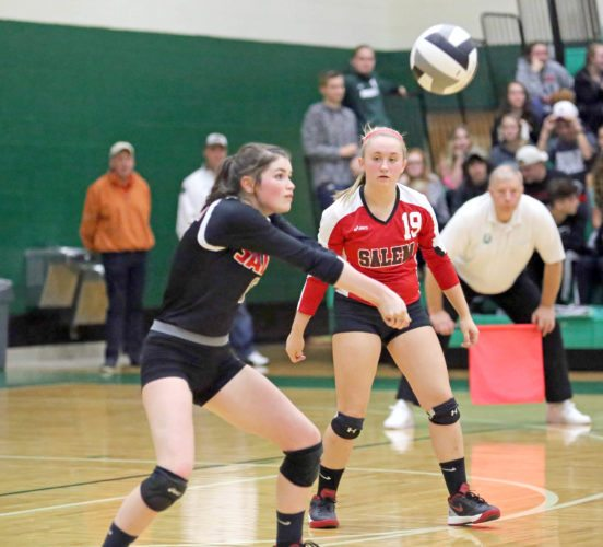 Special to the Journal/Gary Leininger Salem's Alexis Cresanto returns a shot in front   of teammate Kennedy Grimes on Tuesday.