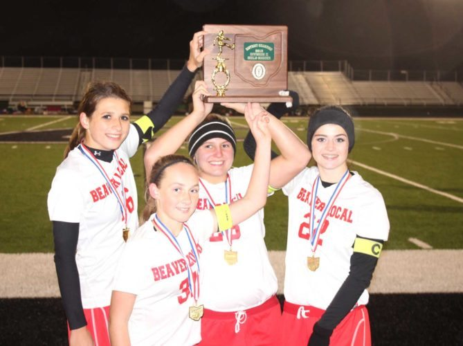 Morning Journal/Joe Catullo Beaver Local captains (from left) Alexa Schwerha, Kierra Taylor, Taylor Wright and Alanna Ice hold up the school's first Div. II district girls soccer trophy since 2002 on Thursday at Carrollton's Field of Dreams. Beaver beat River View 1-0 in overtime to win.