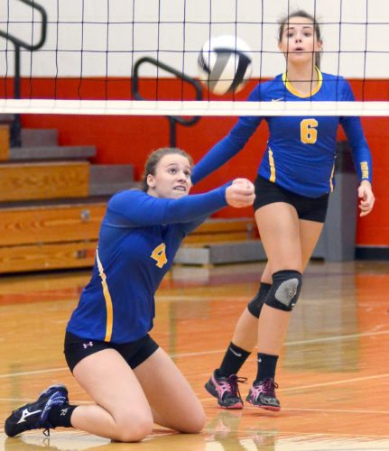 Morning Journal/Patti Schaeffer Southern Local's Natalie May (4) hits her knees and bumps the ball as Hannah Hayes (6) keeps her eye on it Thursday against St. Thomas.