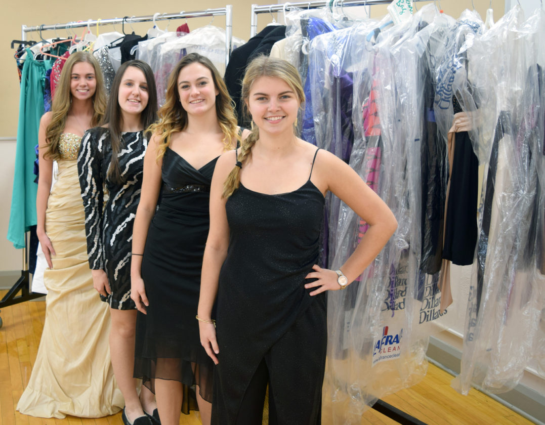 Submitted photo  East Palestine High School seniors (from front) Hayley McElroy, Blair Nulf, Payton Ream and Delaney Snyder model dresses that have been donated to Eppy's Attic.