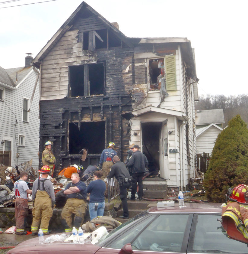 Morning Journal/Tom Giambroni A couple and about 20 pets perished after fire engulfed this Clark Avenue home in Wellsville Sunday morning. One dog was removed alive from the home. The fire was confined mostly to the front of the house, but it filled the rest of the residence with smoke. The cause of the fire remains under investigation, and the state fire marshal's office was called in to assist.