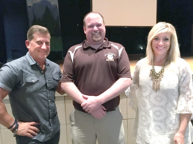Morning Journal/Katie White Phil Chalmers (left) and his wife Wendi (right) visited East Palestine High School Friday for an assembly to caution students about the consequences of bad decisions. With them is high school Principal Chris Neifer.