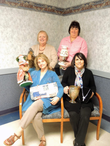 """Submitted photo Salem Regional Medical Center Auxiliary members (front, from left) Sheila Bachmeier, Eileen Gagnon; (back) Jackie Sanor and Ardyth Sommers display some of the items to be featured at the """"Valuables and Vintage Sale from 7 a.m-4:30 p.m. April 3 and 4 in the SRMC private dining room. For more information call 337-2895."""